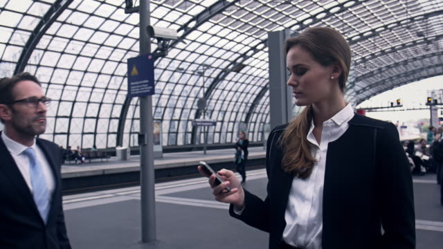 Businesspeople at station