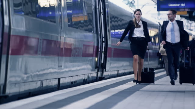 businesspeople at station - urgency stock videos and b-roll footage