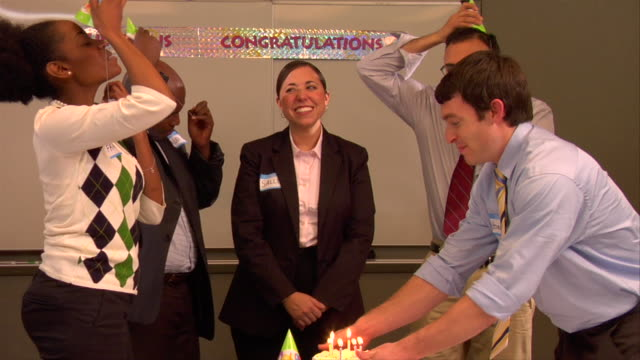 ms, businesspeople celebrating colleague birthday in conference room - party hat stock videos and b-roll footage
