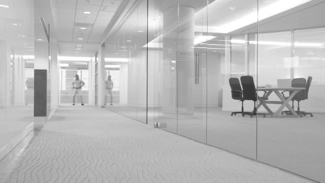 Businesspeople dancing down hallway