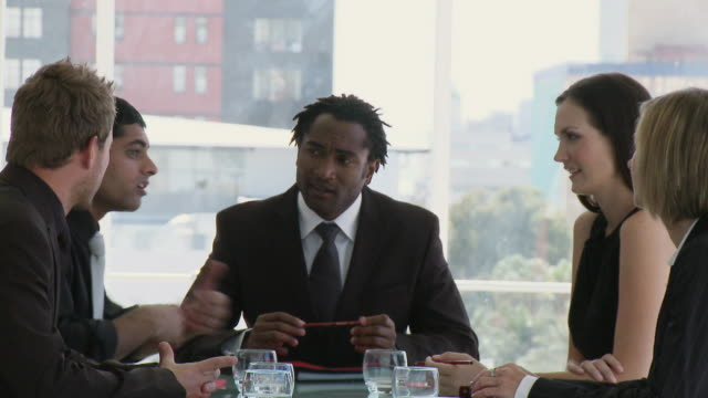 ms businesspeople discussing in meeting / cape town, south africa - employee engagement stock videos & royalty-free footage