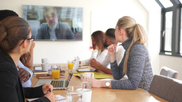Businesspeople having a video conference in board room