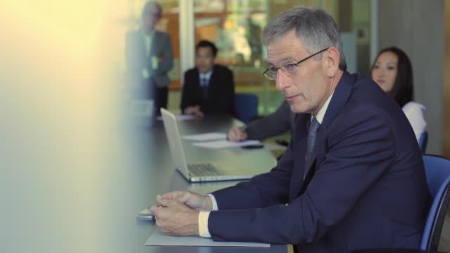 ms pan businesspeople having meeting in boardroom / vancouver, british columbia, canada - grey hair stock videos & royalty-free footage