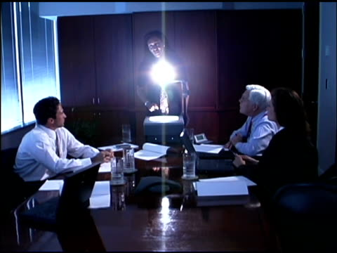 businesspeople in conference room with overhead projector - overhead projector stock videos & royalty-free footage