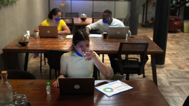 businesspeople in office working with protective face masks - surgical mask stock videos & royalty-free footage