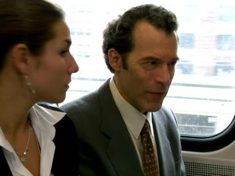 stockvideo's en b-roll-footage met cu, businesspeople in train, chappaqua, new york state, usa - compleet pak