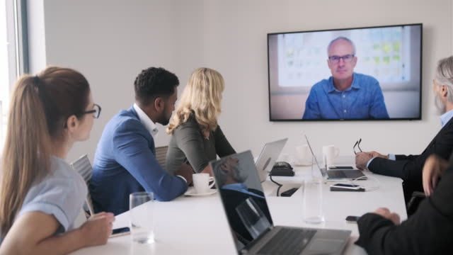 businesspeople participating in video conference - business talk stock videos & royalty-free footage