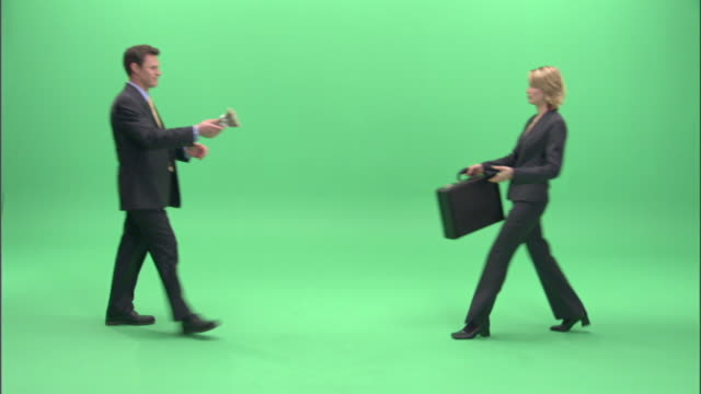ws, businesspeople passing bundle of money and briefcase to each other in studio - bag stock videos & royalty-free footage