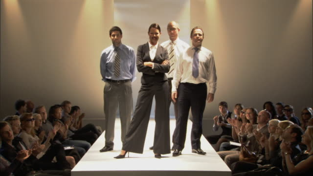 ws businesspeople posing on catwalk while audience applauds / london, england, uk - shirt and tie stock videos & royalty-free footage