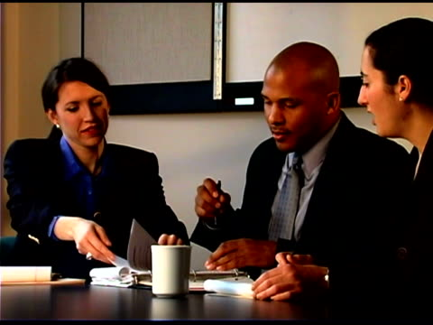 businesspeople talking in conference room - law stock videos & royalty-free footage