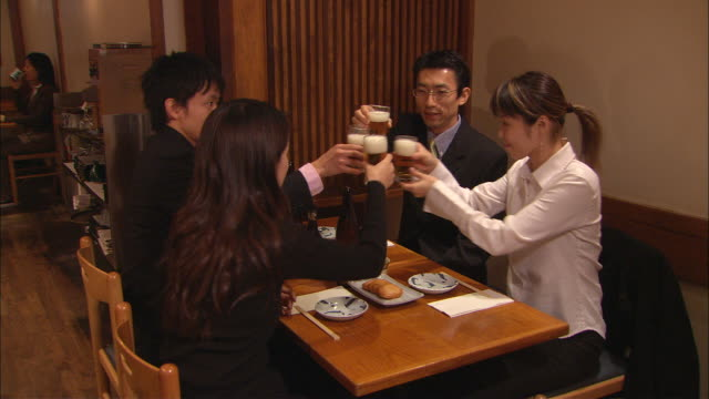 ms, businesspeople toasting with beer in japanese restaurant - happy hour video stock e b–roll