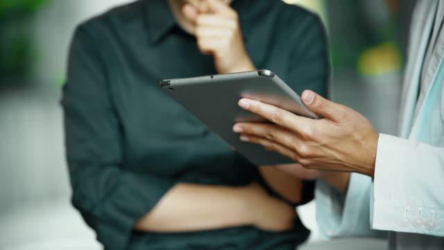 CU Businesspeople using a digital tablet