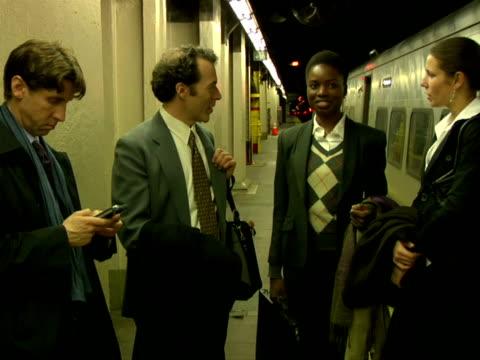 stockvideo's en b-roll-footage met ms, businesspeople waiting on railroad station platform, chappaqua, new york state, usa - compleet pak