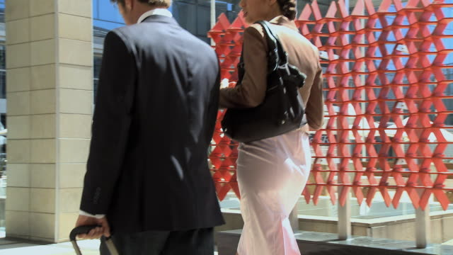 MS PAN Businesspeople walking into hotel / Cape Town, Cape Town, South Africa