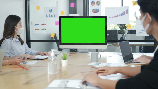 businesspeople watching computer monitor with green screen background in a conference room during covid-19 pandemic - keyable stock videos & royalty-free footage