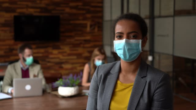 businesspeople working with face masks in the office during covid-19 pandemic - african american ethnicity stock videos & royalty-free footage