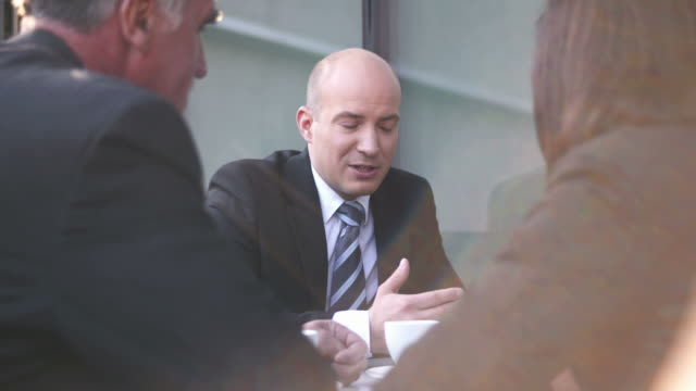 HD: Businessteam Talking During Coffee Break