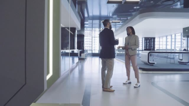 businesswoman and businessman discussing at office - lobby stock videos & royalty-free footage