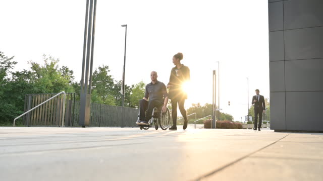 businesswoman and colleague in wheelchair traveling to work - position stock videos & royalty-free footage