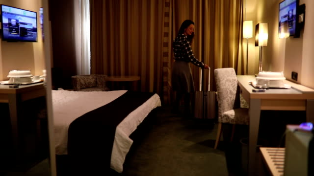 Businesswoman arrives in hotel suite