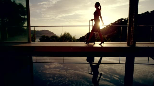 businesswoman arriving to a luxurious spa. - standing water stock videos & royalty-free footage