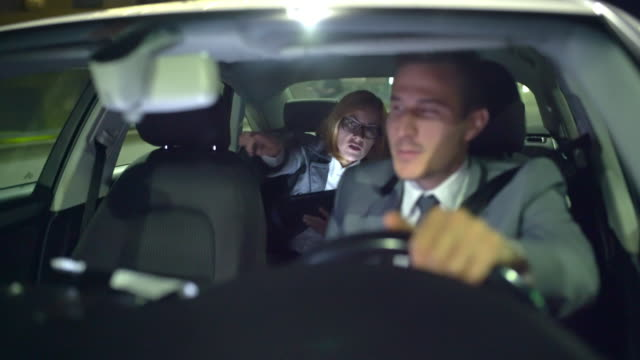 WS Businesswoman being driven by a limousine driver