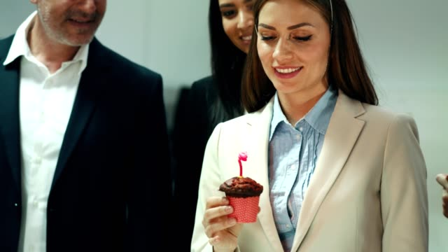 businesswoman blowing out candle - party hat stock videos and b-roll footage