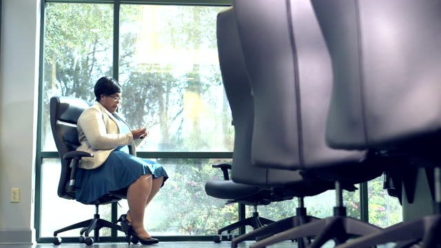 Businesswoman boardroom talking on phone, pacing