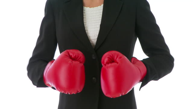 businesswoman boxing - boxhandschuh stock-videos und b-roll-filmmaterial