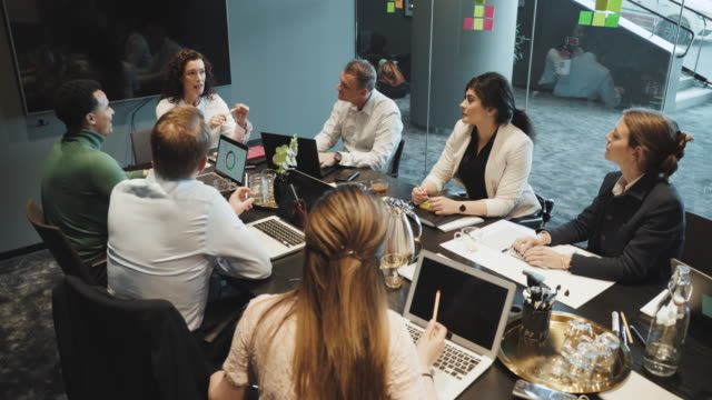 businesswoman brainstorming multi-ethnic colleagues in board room during sales pitch meeting at coworking office - geschäftsgründung stock-videos und b-roll-filmmaterial