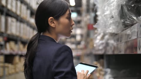 businesswoman check list product in stock at warehouse, quality control check - quality control stock videos & royalty-free footage