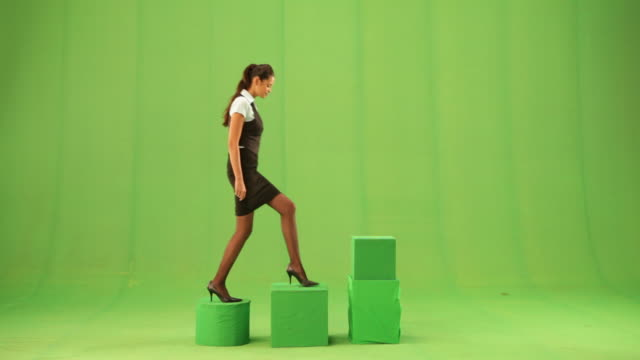 businesswoman climbing a steps  - steps stock videos & royalty-free footage