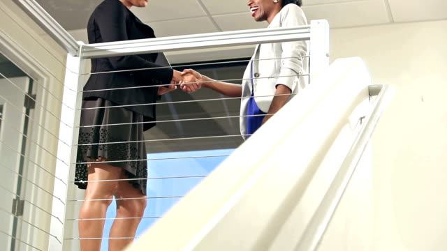 businesswoman climbs stairs, shakes hands with colleague - low section stock videos and b-roll footage