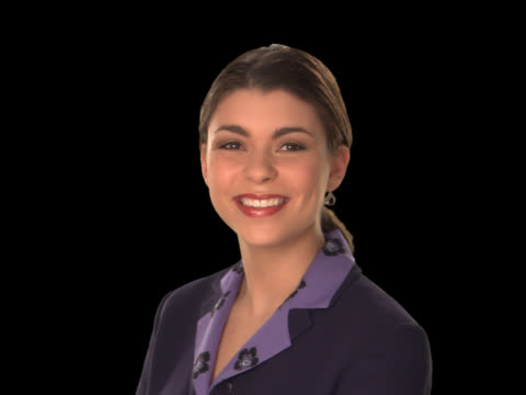businesswoman close-up smiling - this clip has an embedded alpha-channel - pre matted stock-videos und b-roll-filmmaterial