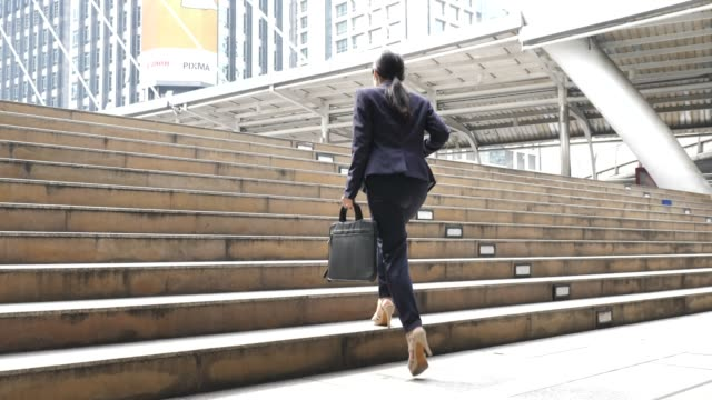 businesswoman commuting to work - staircase stock videos and b-roll footage