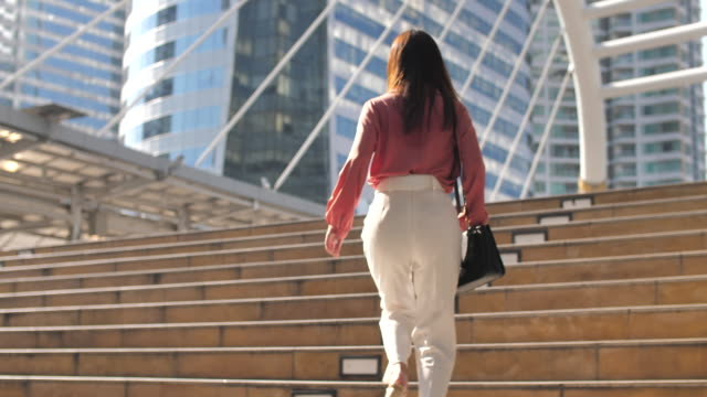 businesswoman commuting to work - staircase stock videos & royalty-free footage