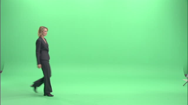 ws, businesswoman dancing in studio - full length stock-videos und b-roll-filmmaterial