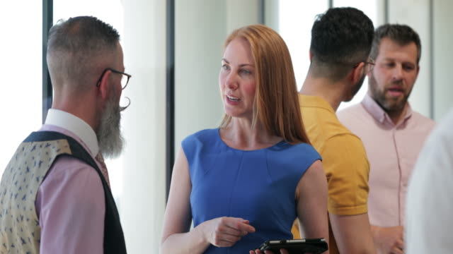 businesswoman discussing with colleague - conference event stock videos & royalty-free footage
