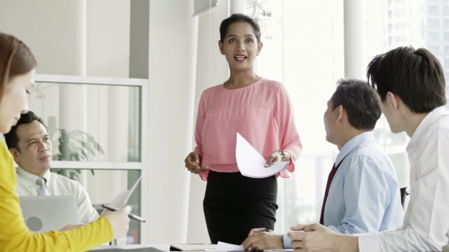 businesswoman discussing with colleagues at meeting - malaysian ethnicity stock videos & royalty-free footage