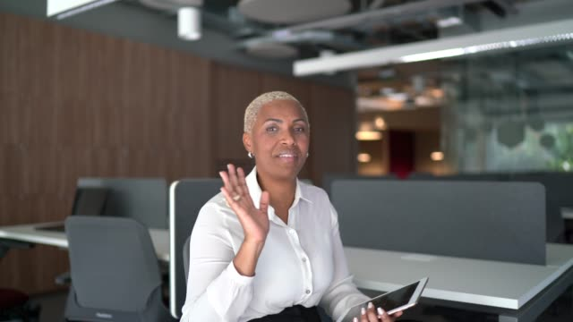 businesswoman doing a video call at work - camera point of view - distant stock videos & royalty-free footage