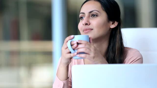 Businesswoman drining tea, Delhi, India