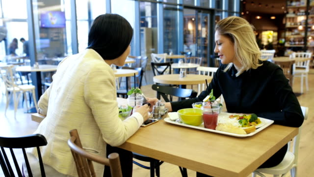 businesswoman during lunch, handheld shot - canteen stock videos & royalty-free footage
