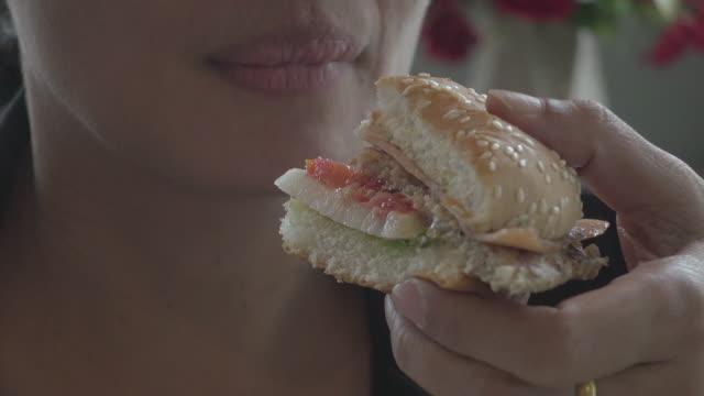 businesswoman eat hamburger in restaurant - sauce stock videos & royalty-free footage