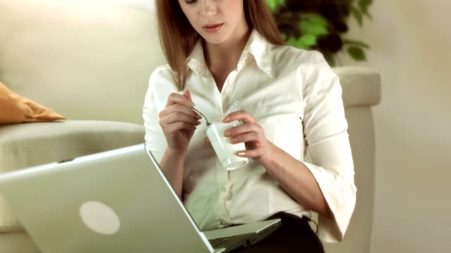 hd: businesswoman eating yogurt - yoghurt stock videos and b-roll footage