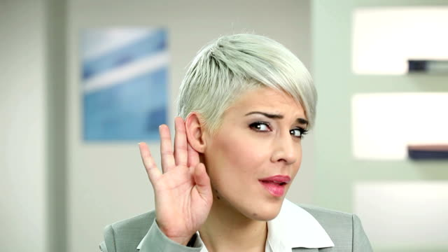 businesswoman eavesdropping - human ear stock videos & royalty-free footage