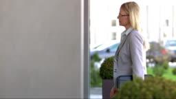 DS TU Businesswoman Entering The Office Building