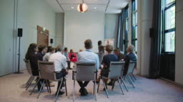 Businesswoman explaining strategy in seminar