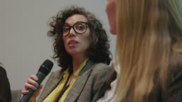 Businesswoman explaining strategy to emcee