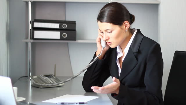 businesswoman getting bad news by the phone. - landline phone stock videos and b-roll footage