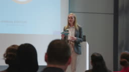 Businesswoman giving presentation in conference